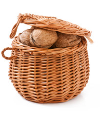basket with walnuts isolated on a white backgroun