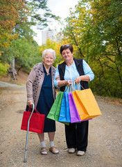 Two women with shopping bags in the street