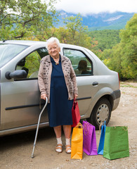 Old woman with shopping bags