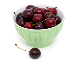 cherries in a green bowl
