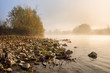 horizontal river pebble beach in Foggy morning