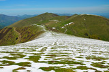 Green mountain ridge with snowfields of the spring Pyrenees