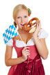 Woman with bavarian flag and pretzel