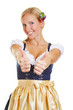 Woman in dirndl holding two thumbs up