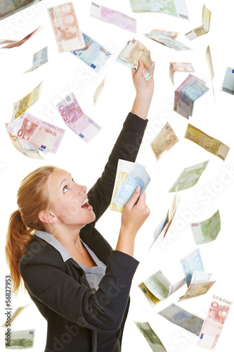 Business woman catching flying Euro money