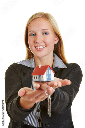 Woman with house and keys on hand