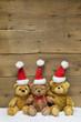 Team - drei Teddy senden Weihnachtsgrüße - Holz - Hintergrund