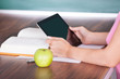 Student holding digital tablet