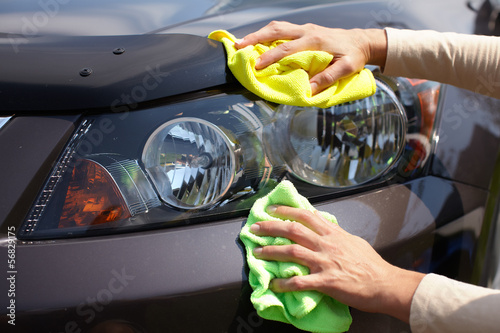 Hand polishing car.
