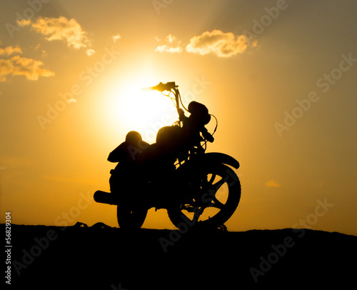 Silhouette of a motorcycl on a background of dark sky