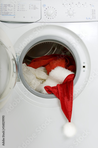 Christmas wash: washing machine with a red Santa suit