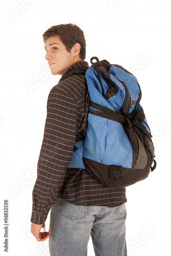 Casual dressed young man with blue backpack looking over shoulde