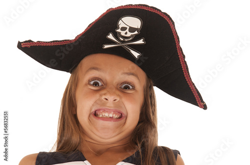 Young girl in pirate's hat pulling a very funny face