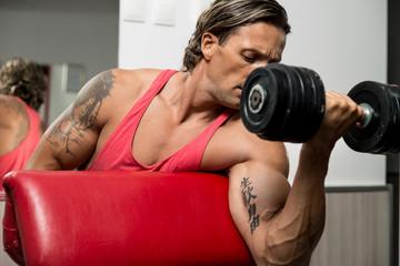 Powerful Muscular Man Lifting Weights