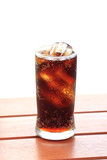 glass of cola with ice with copy-space in composition.