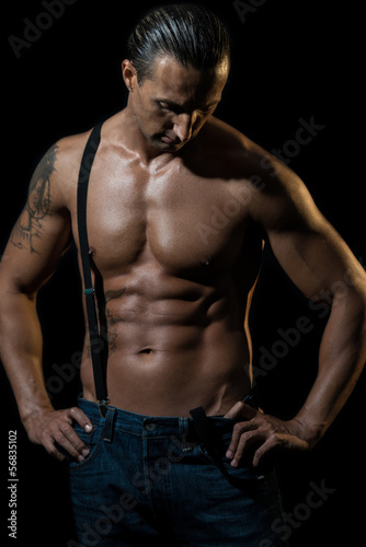 Sexy man with black suspenders over naked chest