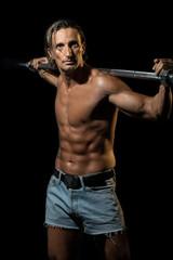 Bodybuilder Exercising Isolated On Black Background