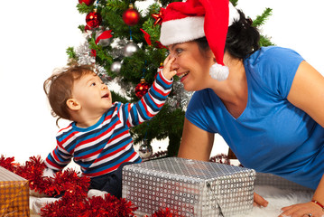 Funny mother with her baby at Christmas