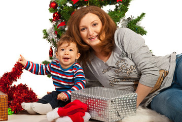 Happy mom and son celebrate first Christmas