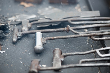 Vintage blacksmith's instruments, close-up, horizontal shot