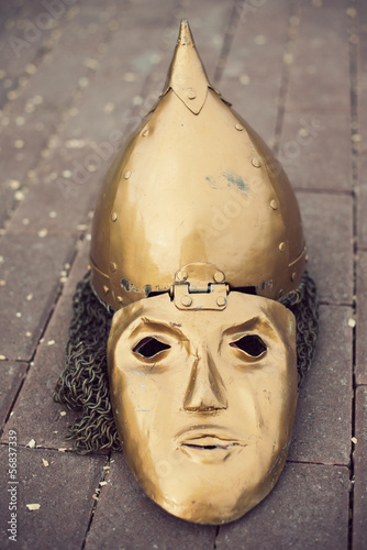 Medieval slavic helmet with a face mask, vertical shot
