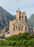 Cement plant with limestone mountain background