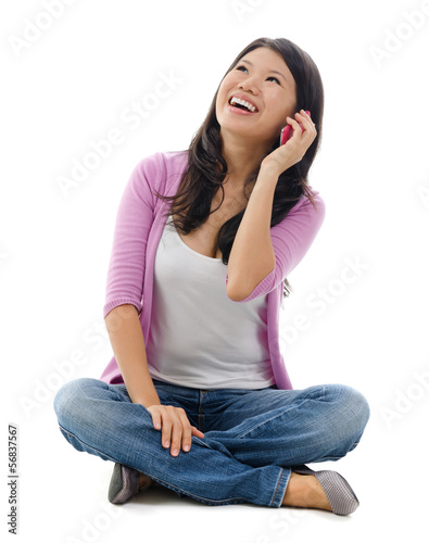 Asian woman talking on smartphone