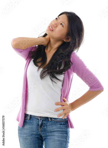Tired Asian woman having neck and shoulder pain