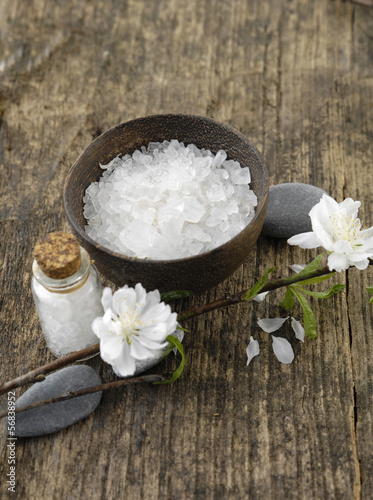 grey stones and spring flower, salt in glass on old wood