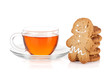 Glass cup of black tea with homemade cookies and gingerbread man