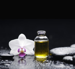 Spa still with massage oil, orchid pebbles