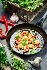 Shrimps served on a pan with herbs