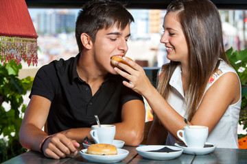 Couple playing around at breakfast.