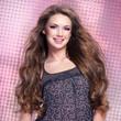 Beautiful  young smiling woman with long hairs looking at camera