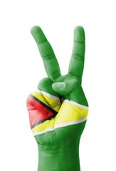 Hand making the V sign, Guyana flag painted