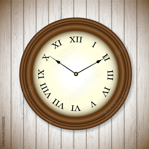 vintage clock on wooden background