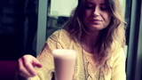 Beautiful woman drinking cappuccino in cafe
