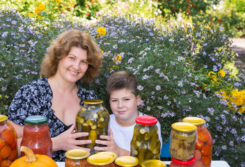 Mom with her son and home canned vegetables