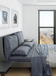 Comfortable bedroom interior with grey double bed