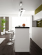 Modern white and green kitchen interior with two bar stools