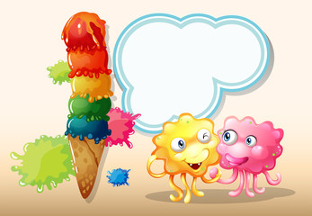 A pink and an orange monster beside the giant icecream