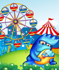 A carnival with a mother monster carrying her baby
