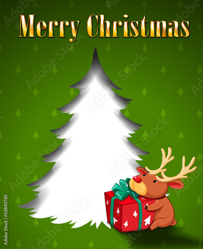 A green christmas card with a reindeer hugging a gift