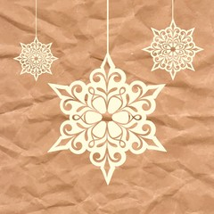 Snowflakes.  Christmas decoration on crumpled paper background.