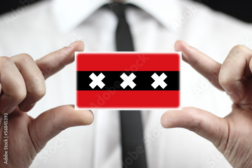 Businessman holding a business card with a Amsterdam City Flag