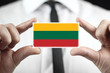 Businessman holding a business card with a Lithuania Flag