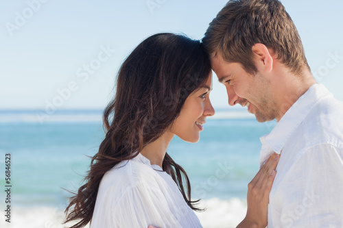Attractive couple embracing on the beach