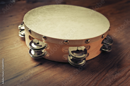 Wooden tambourine on a table