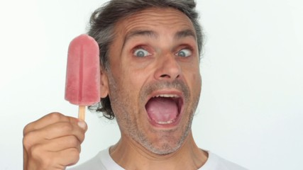 man eating red  popsicle over white background