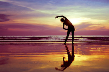 stretch before gym on the beach, silhouette of woman